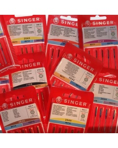 Various types and sizes of Singer universal sewing amchine needles